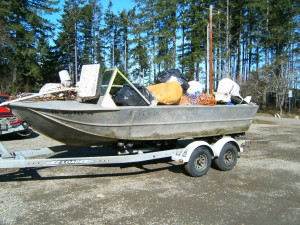 Squaxin Island Tribe's Natural Resources boat loaded with trash found on the island
