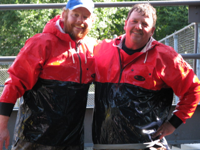Joe Peters and Will Henderson taking a break from sorting fish